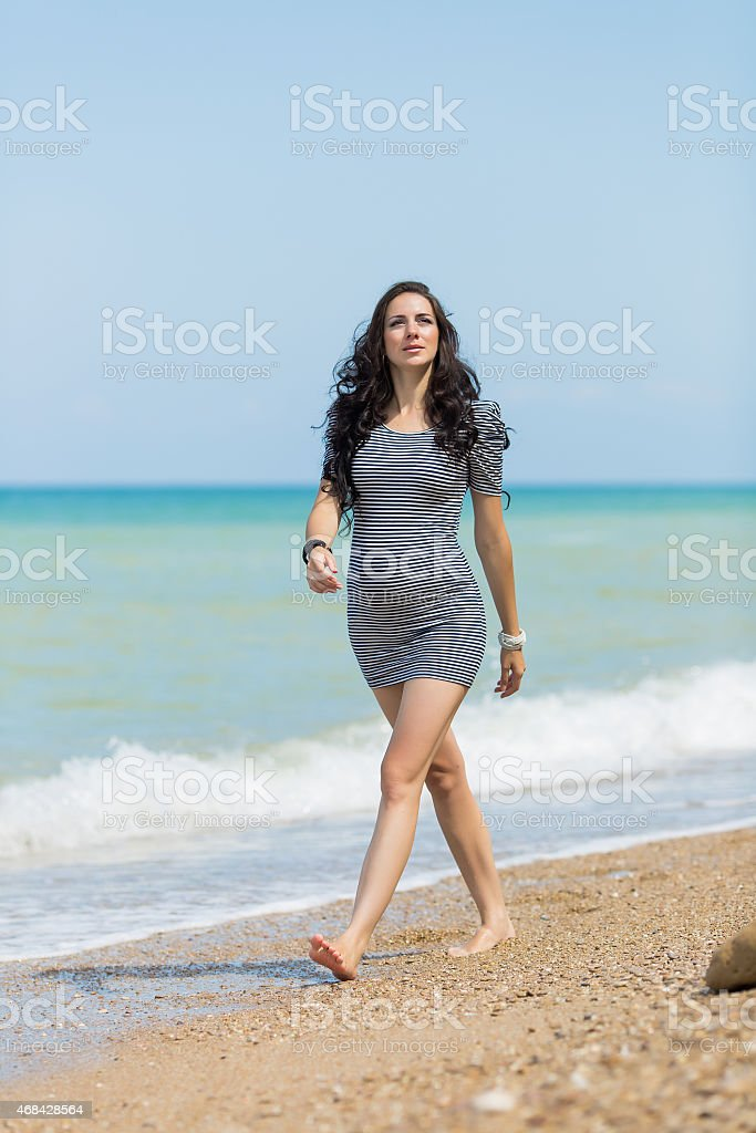 Expectant mother on the beach stock photo