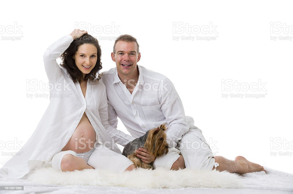 Expecting Couple with dog royalty-free stock photo