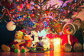 Expecting for Christmas miracles. Many toys under illuminated fir