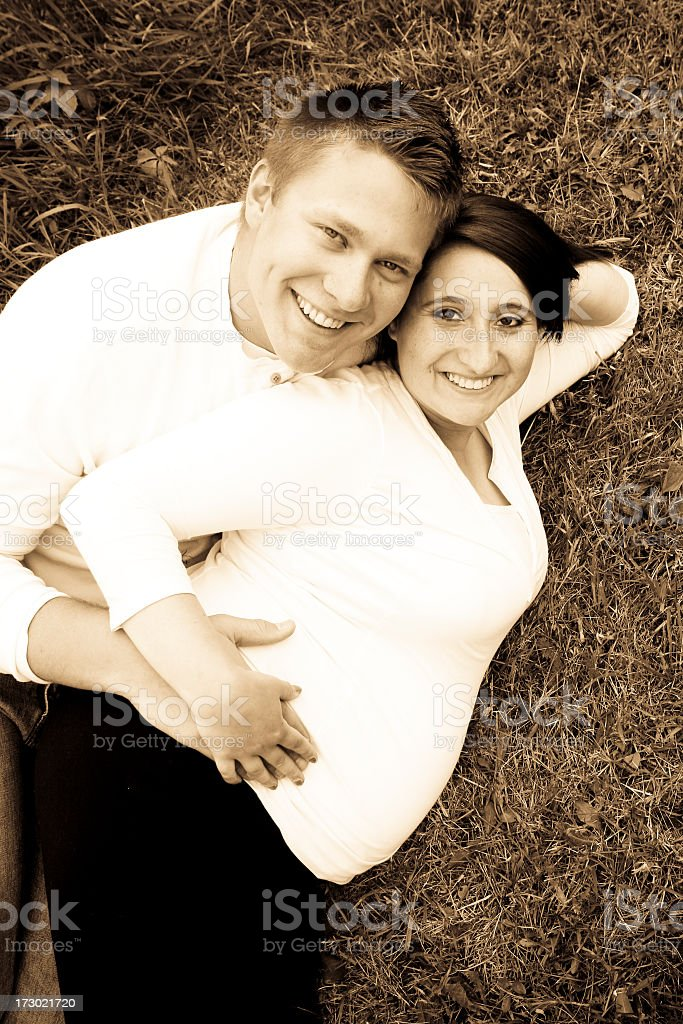 expecting young couple in sepia royalty-free stock photo