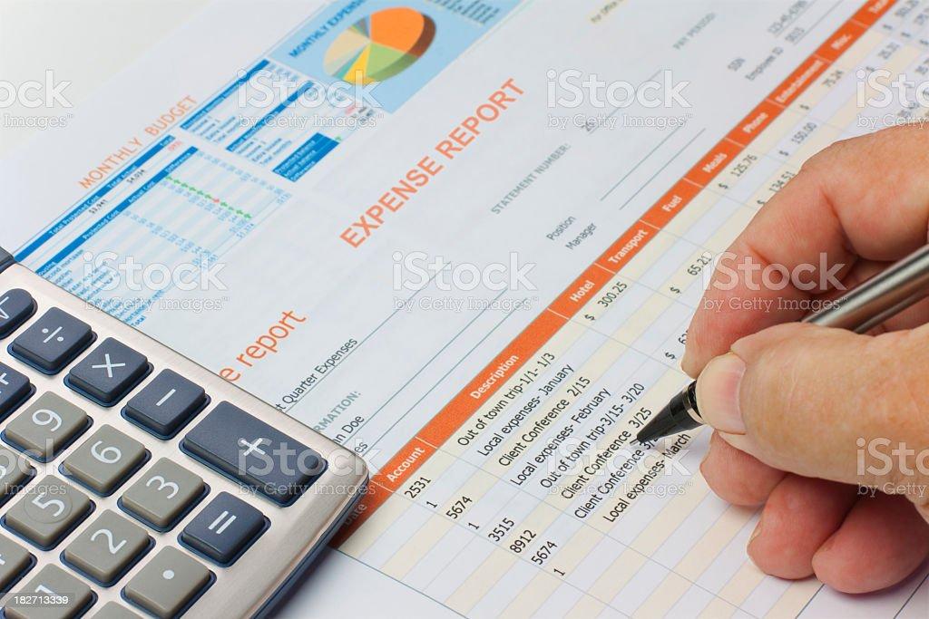 Expense Budget Report, hand, calculator stock photo