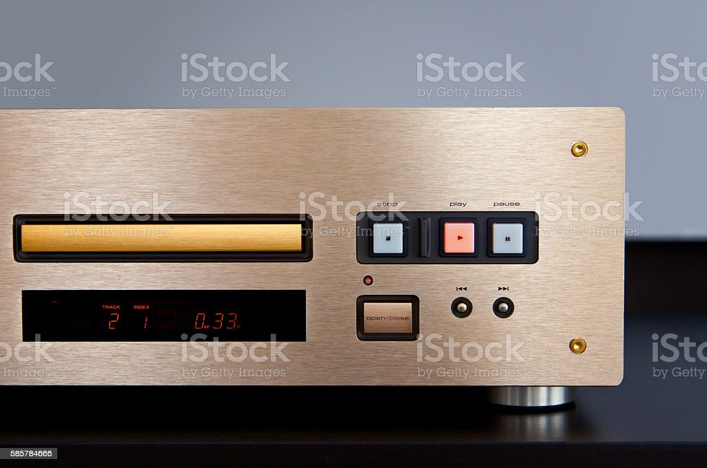 Expensive CD Player Playing Music with Golden Front Panel stock photo