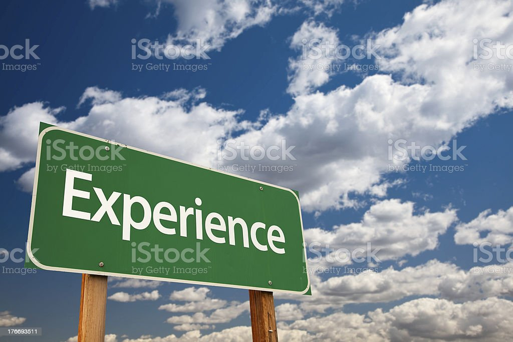 Experience Green Road Sign stock photo