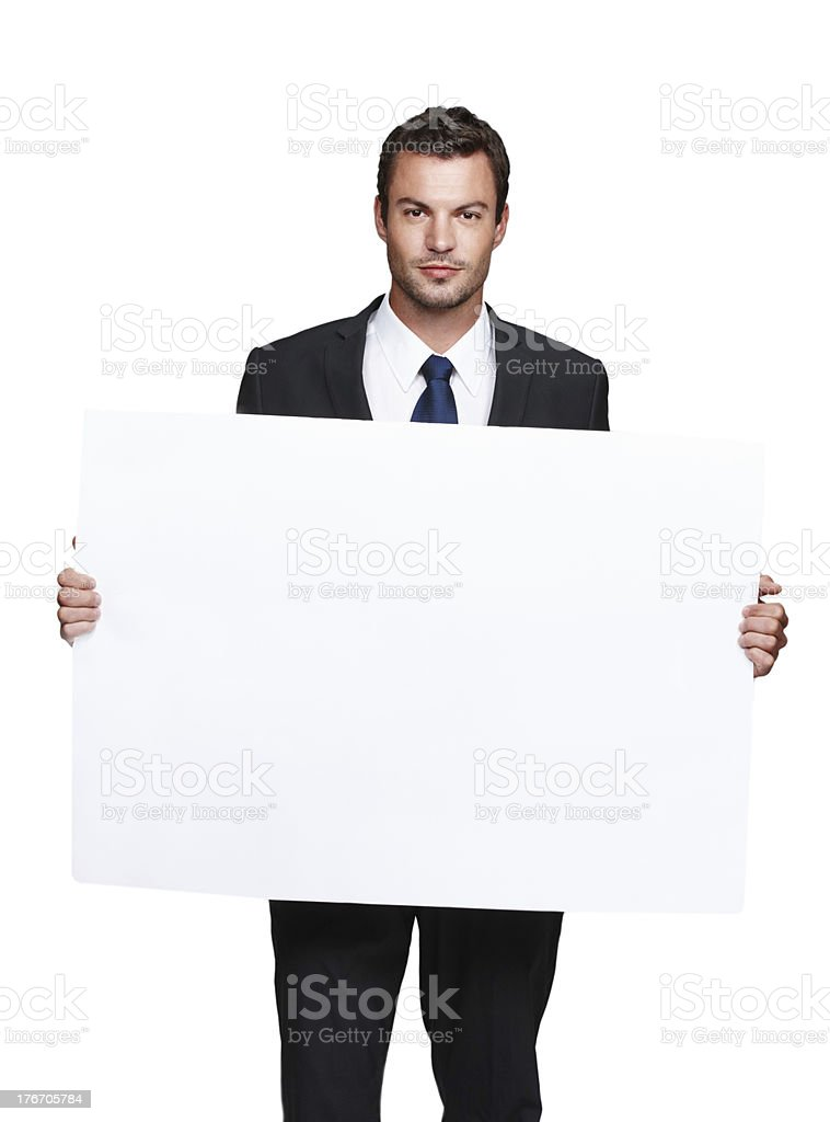 Experienced businessman endorsing your product royalty-free stock photo