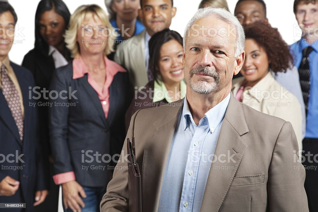 Experienced businessman in front of peers royalty-free stock photo