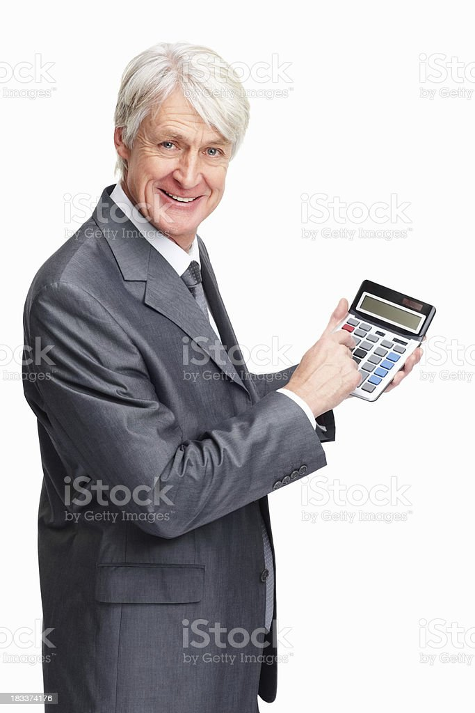 Experienced businessman using calculator royalty-free stock photo