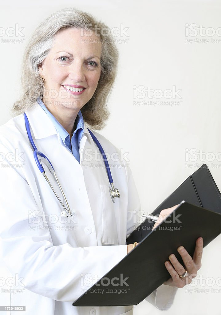 Experienced Happy Female Doctor Taking Notes royalty-free stock photo