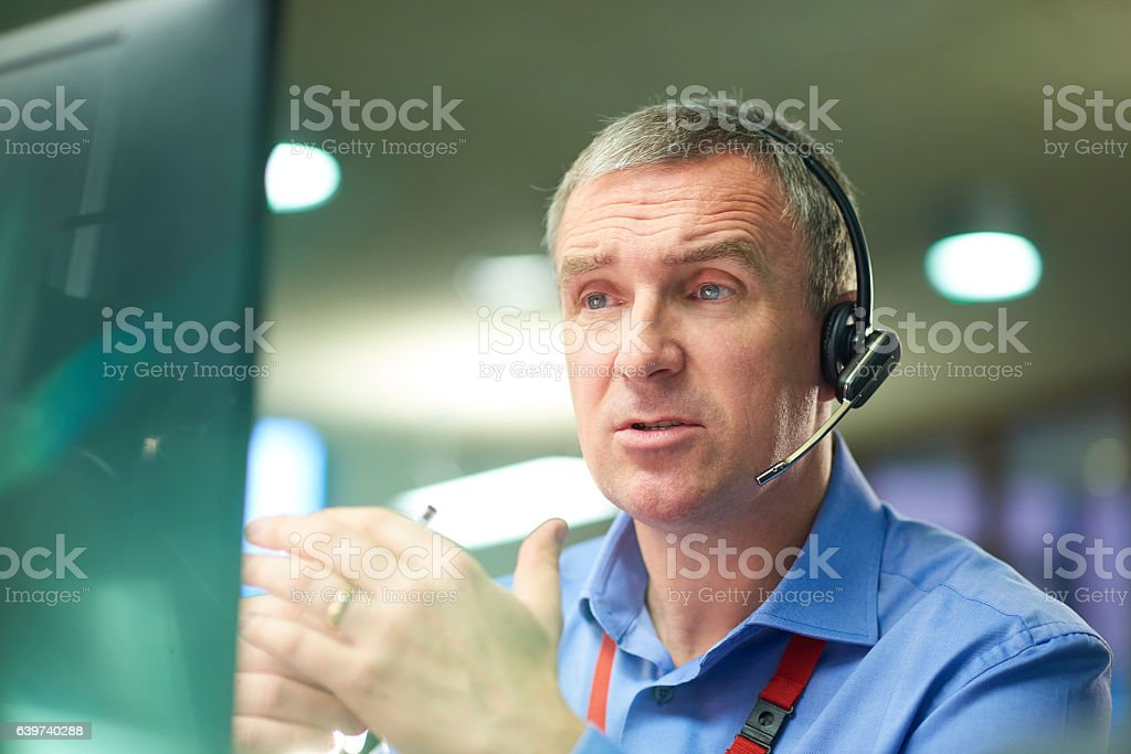 experienced male call handler stock photo