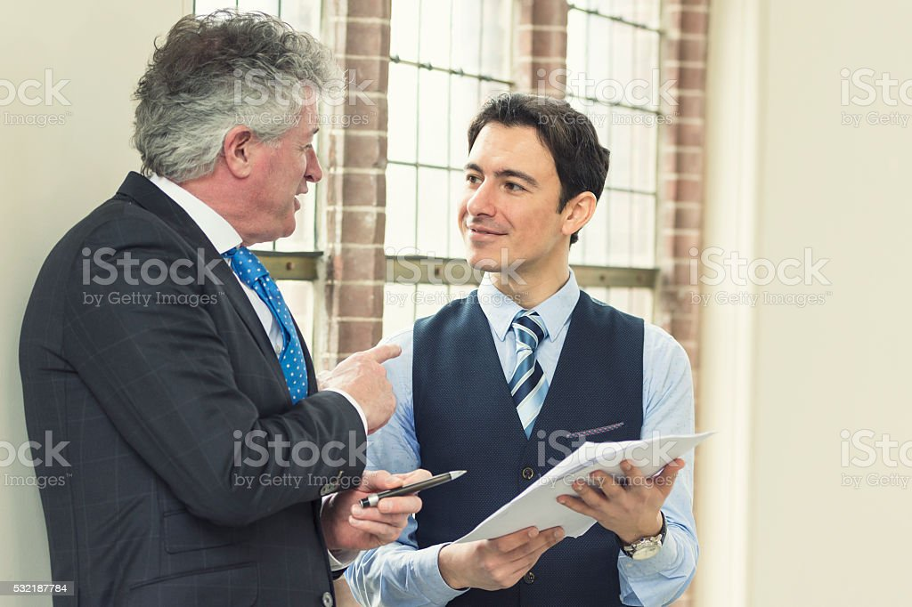Experienced manager with young employee stock photo