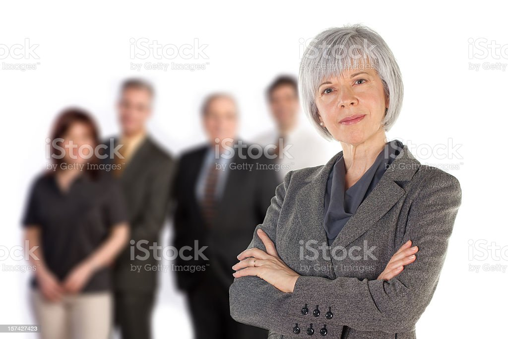Experienced Woman with her Team royalty-free stock photo