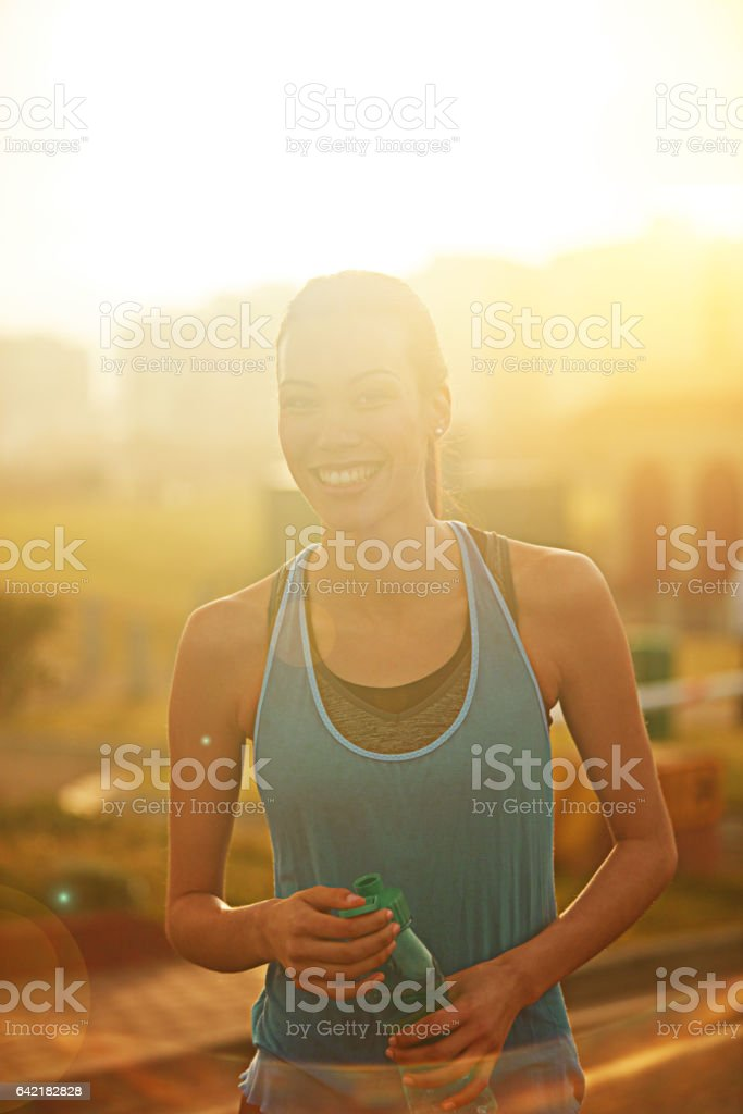 Experiencing a sense of elation and happiness after her run stock photo