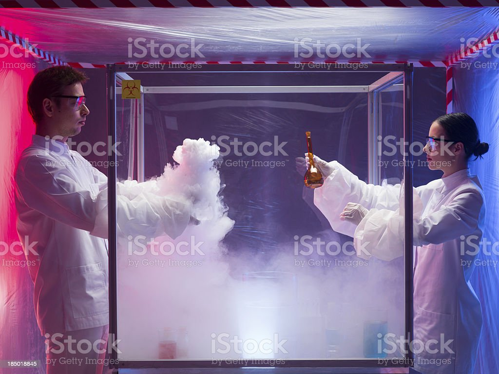 experimenting in a sterile chamber stock photo