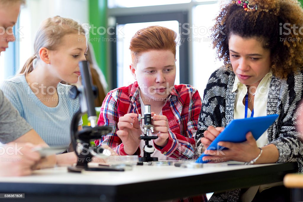 Experimenting with Microscopes in a Science Lesson stock photo