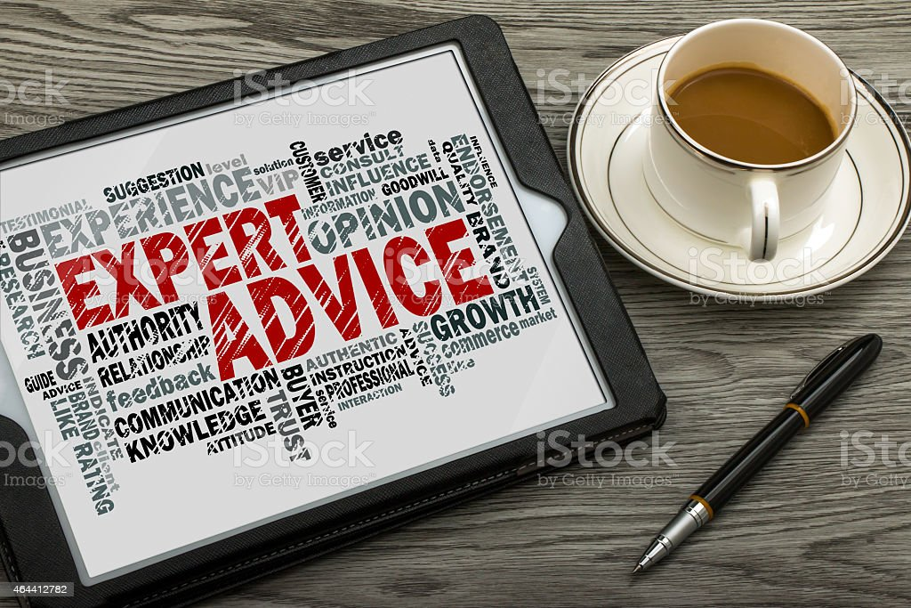 Expert advice word cloud on notebook with coffee and pen stock photo