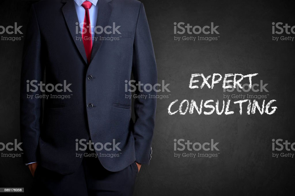 Expert consulting written on blackboard stock photo