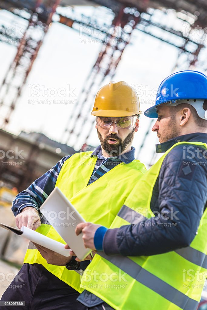 Expert engineers on construction site in Europe stock photo