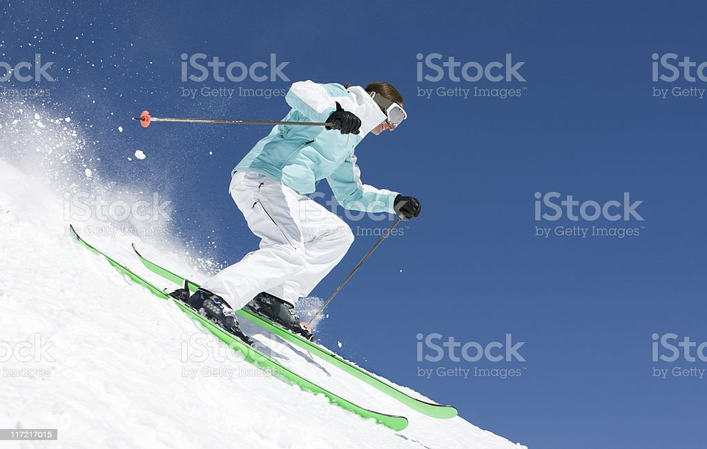 Expert Female Skier Against A Blue Sky royalty-free stock photo