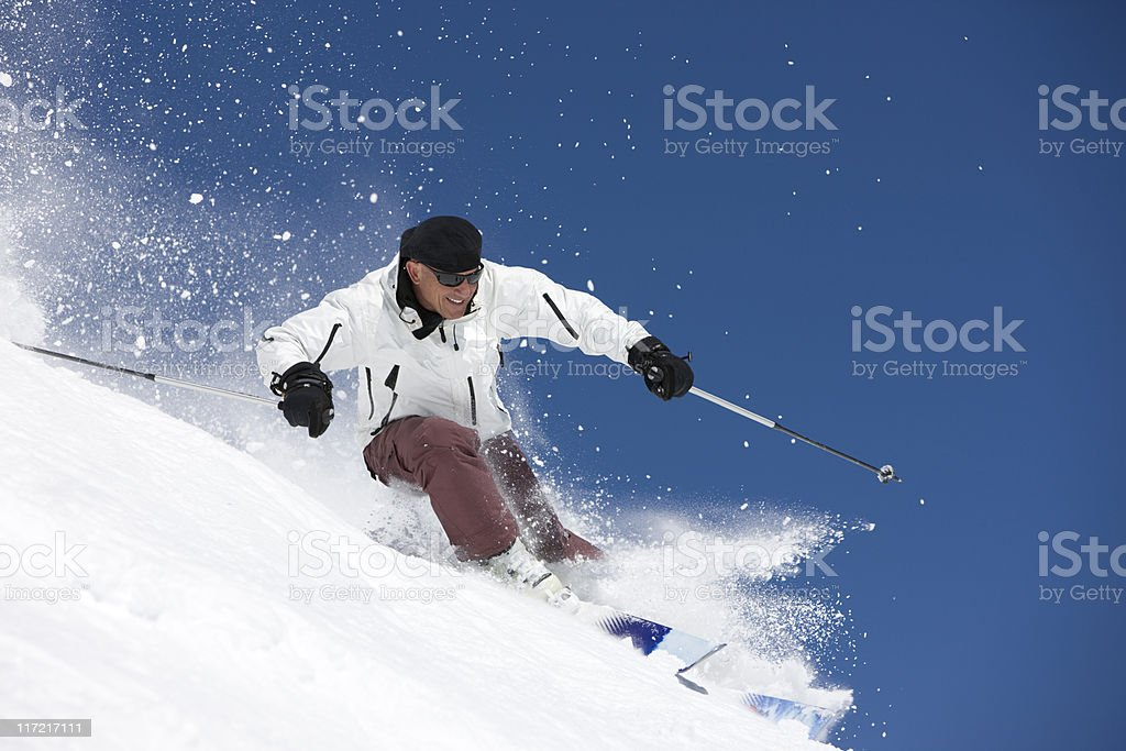 Expert Skier Against A Bright Blue Sky royalty-free stock photo