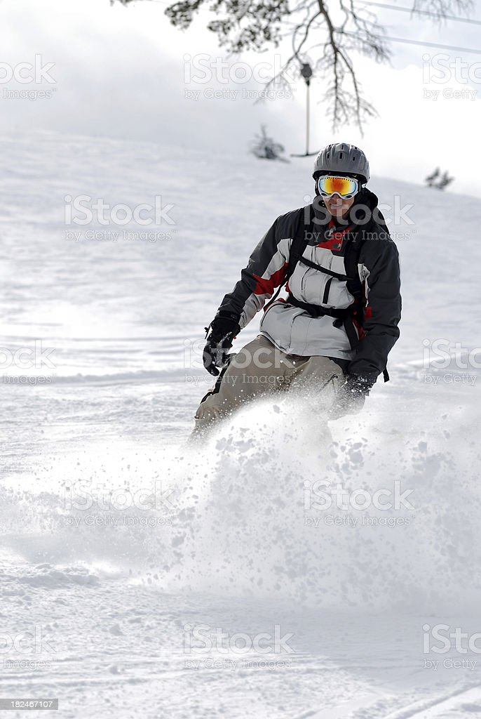 expert snowboarding on back light stock photo