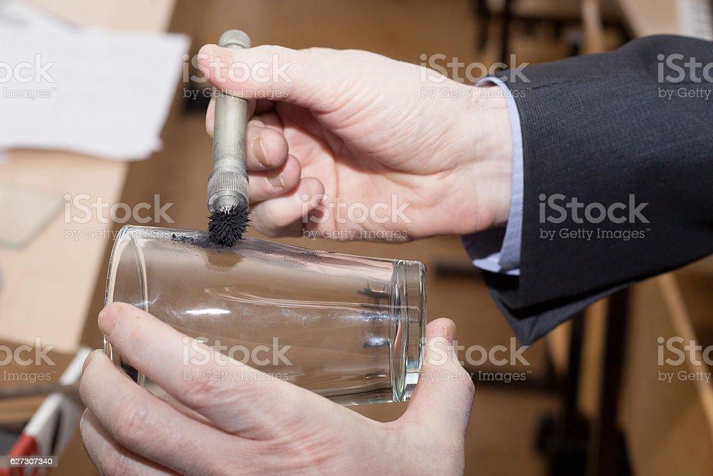 Expert takes fingerprints from the glass stock photo