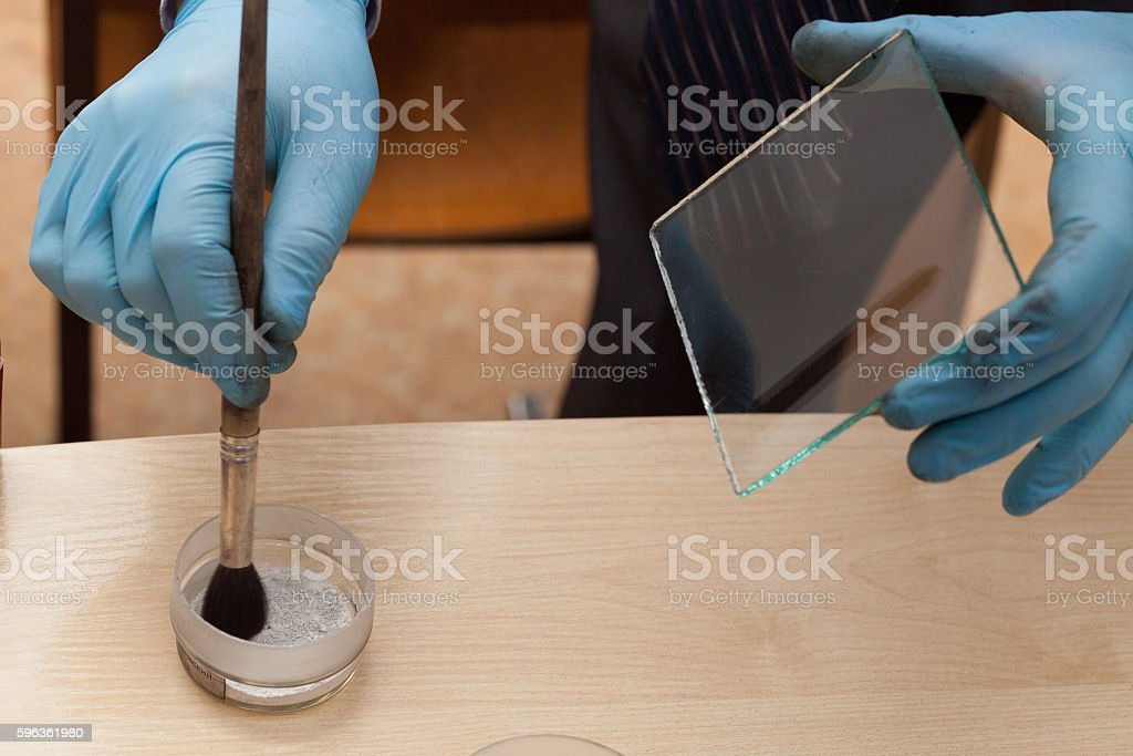 Expert takes fingerprints. investigation of the crime. stock photo