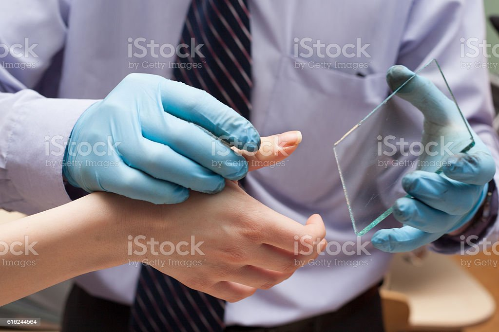 Expert takes fingerprints. investigation of the crime. stock photo
