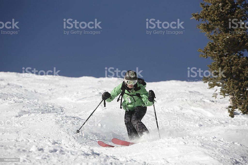 expert woman mogul skier stock photo