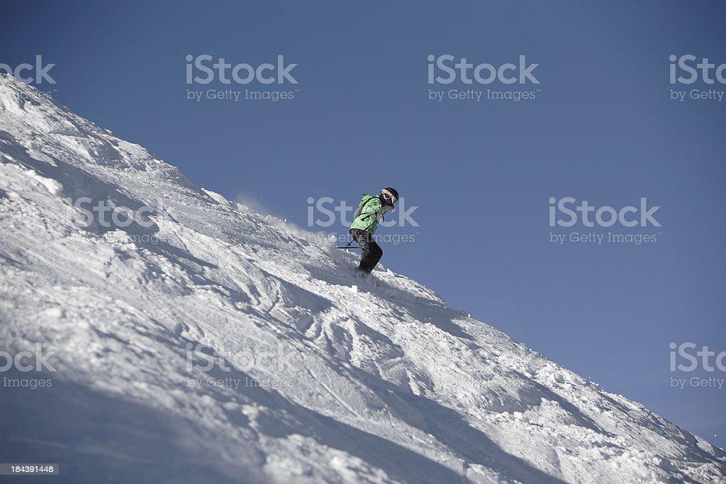 expert woman skier on a steep mogul slope stock photo