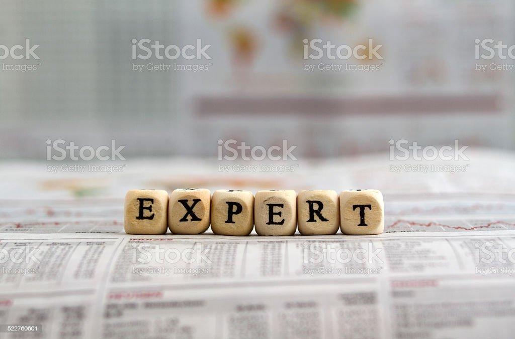 Expert word on newspaper stock photo