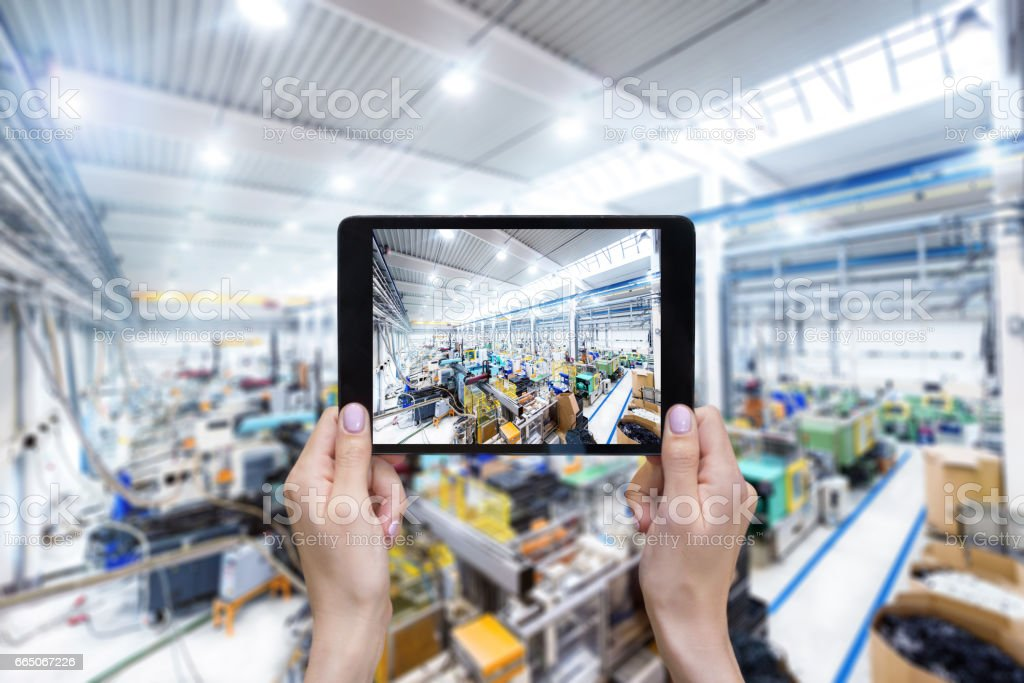 Expertise & touchpad & factory stock photo