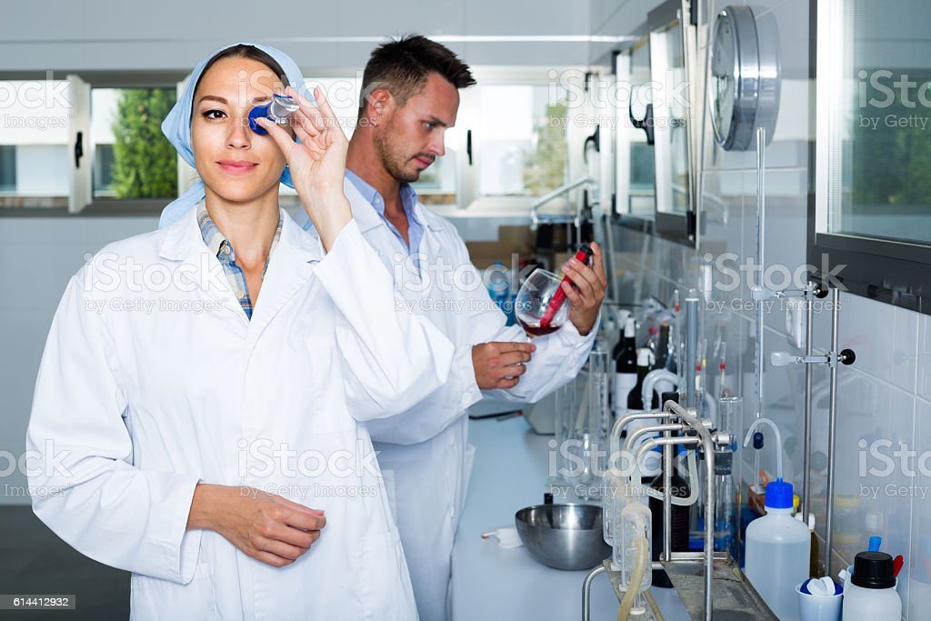 experts making tests in winery laboratory stock photo