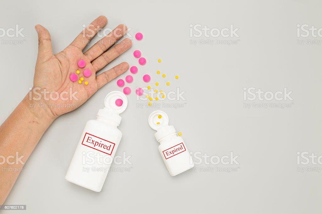 Expired drug on elderly hand stock photo