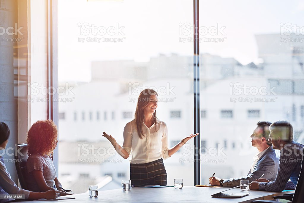 Explaing her ideas in detail stock photo