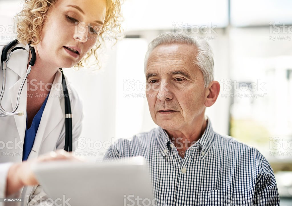 Explaining her diagnosis in detail stock photo