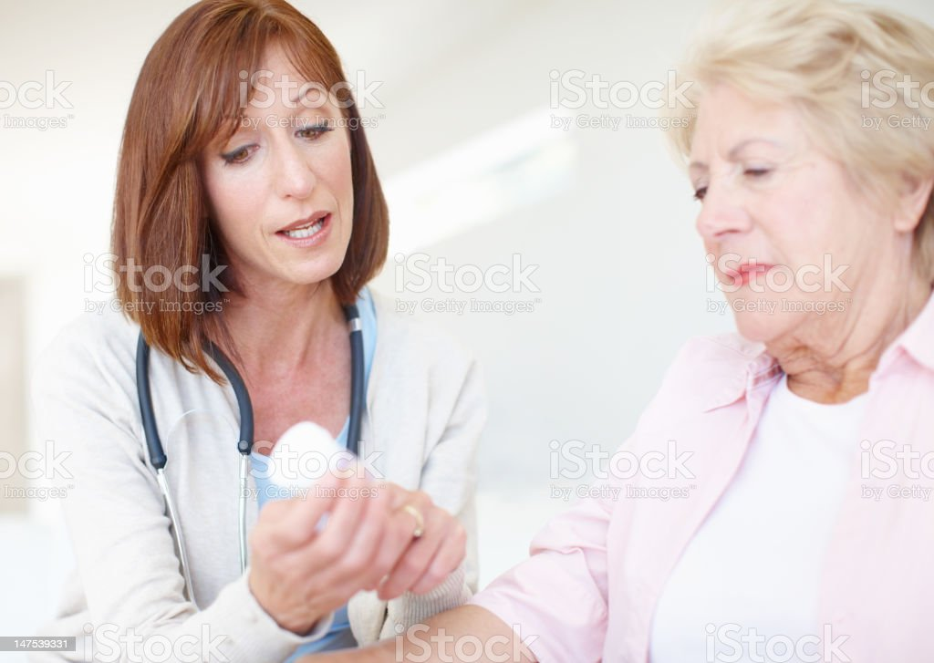 Explaining the dosage and effects - Senior Care royalty-free stock photo