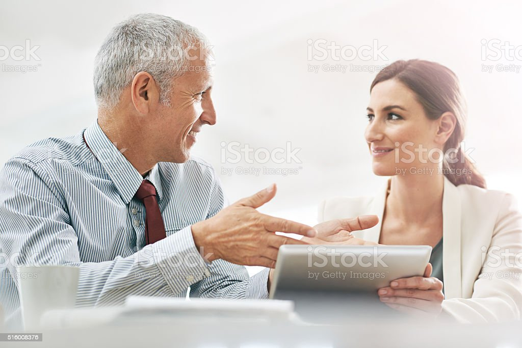 Explaining the finer points of business stock photo