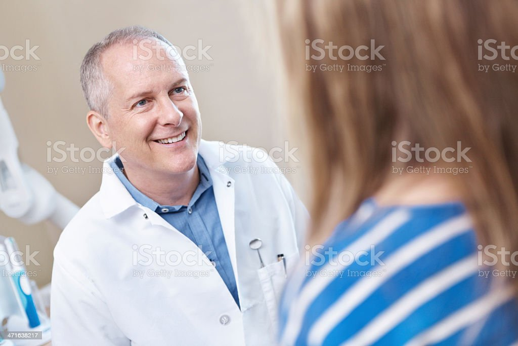 Explaining to the dentist how she chipped her tooth royalty-free stock photo