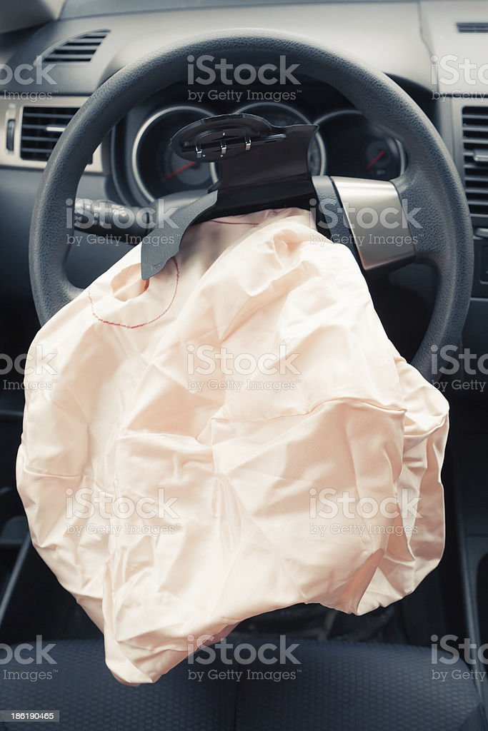 Exploded airbag on steering wheel stock photo