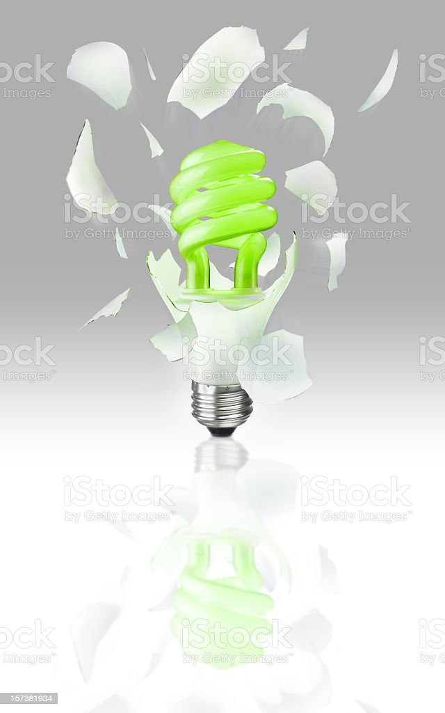 Exploding Light Bulb on gray royalty-free stock photo