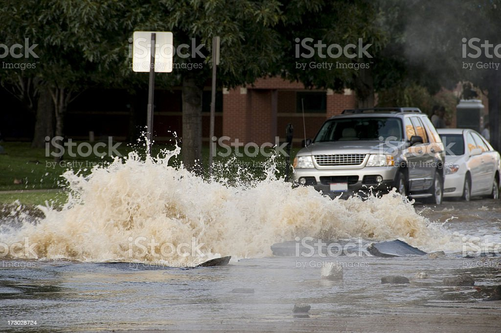 Exploding Water Main Causes Flooding stock photo