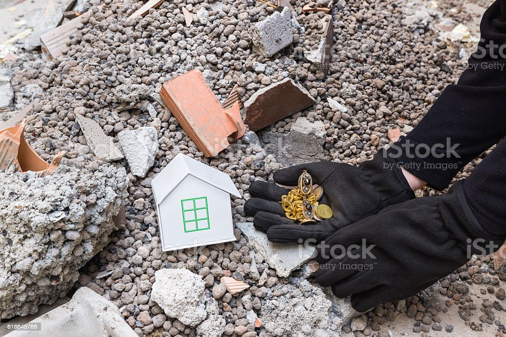 Exploiter thief loots a house devastated by earthquake stock photo