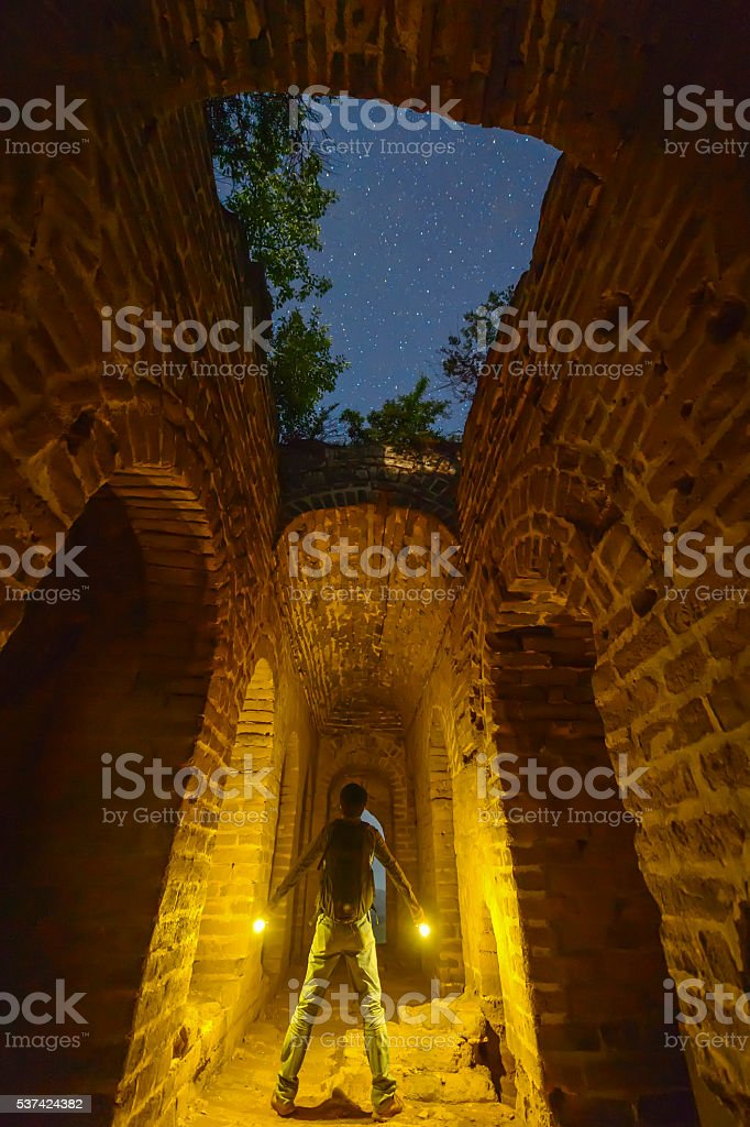 Explore the ancient Great Wall at night stock photo