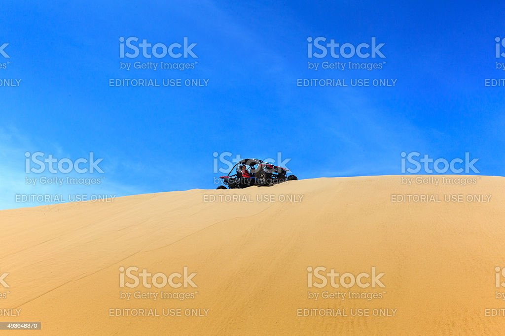 explore the dunes by terrain vehicles stock photo