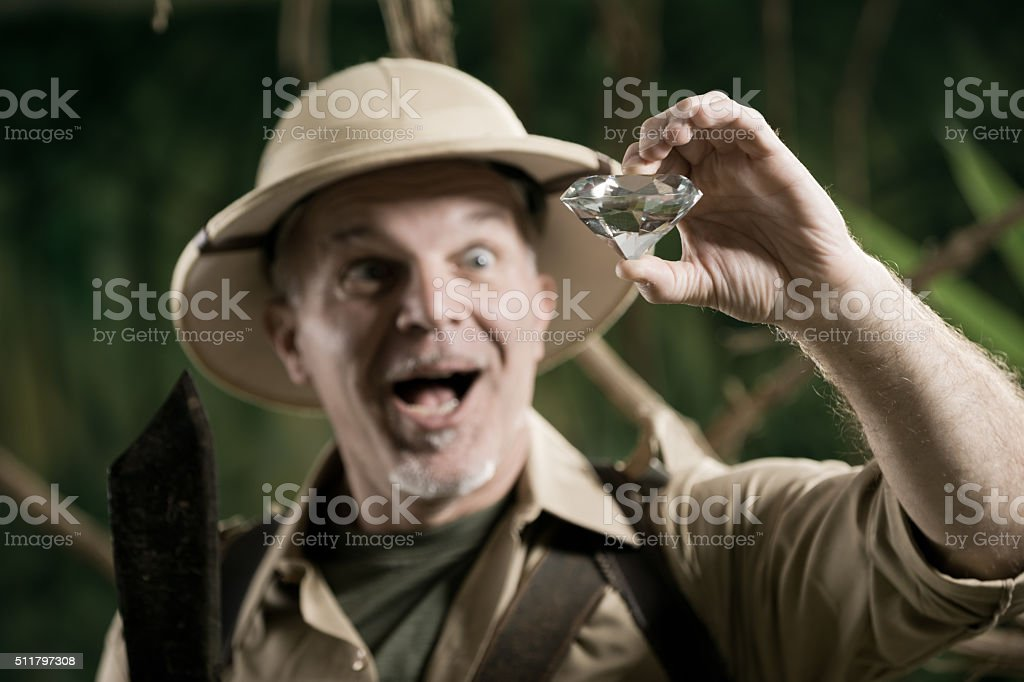 Explorer finding a huge gem in the jungle stock photo