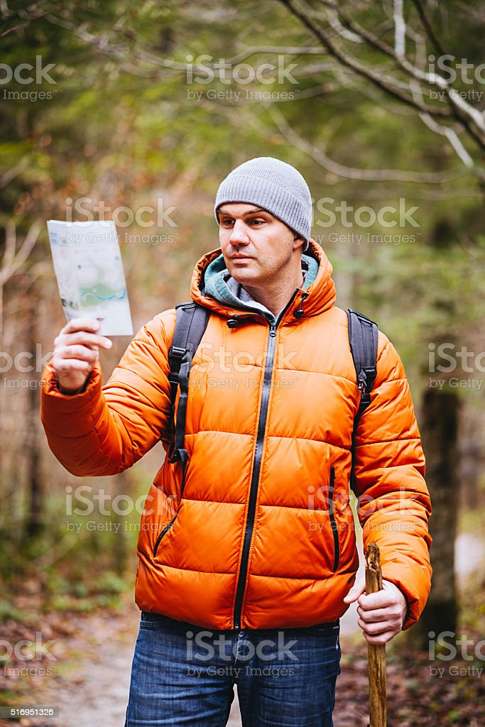 Explorer hiking in national park and finding directions near river stock photo