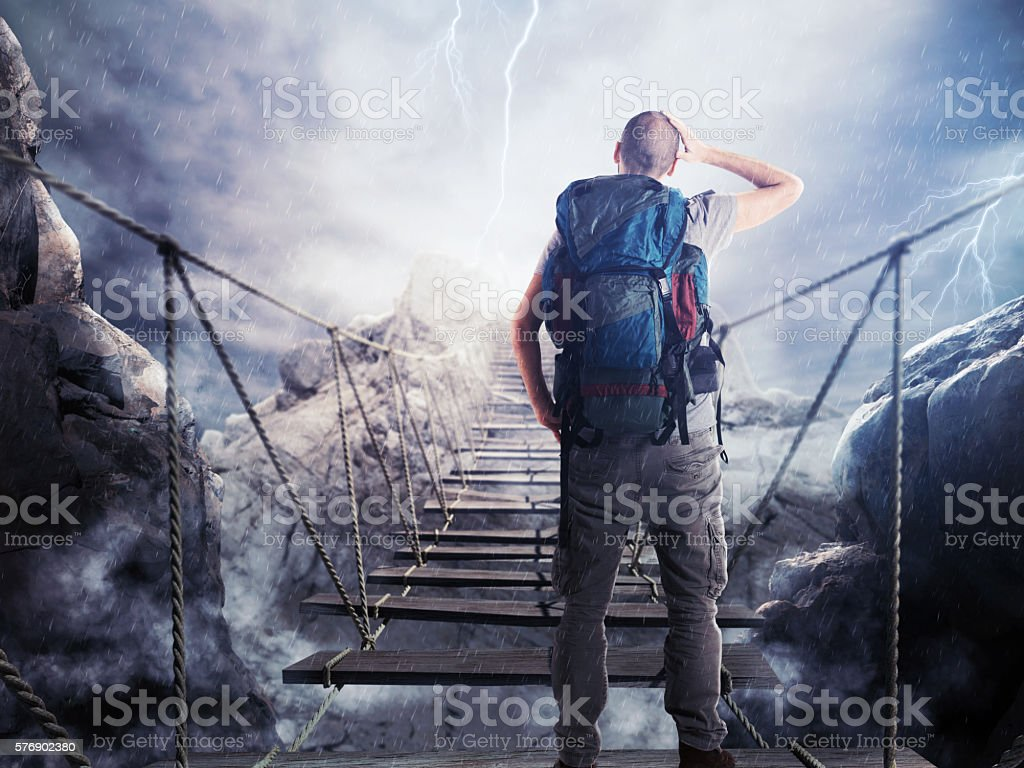Explorer on unstable bridge stock photo