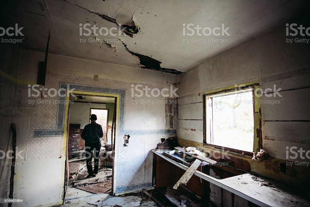 Explorer Walking Inside Abandoned Home stock photo