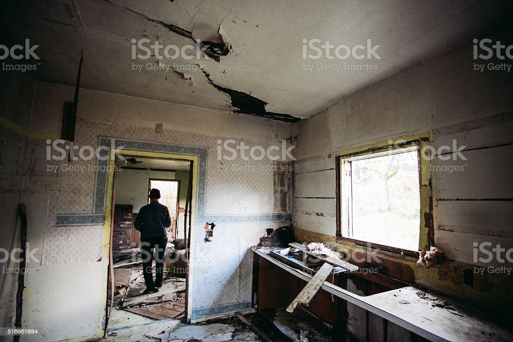 Explorer Walking Inside Abandoned Home stock photo