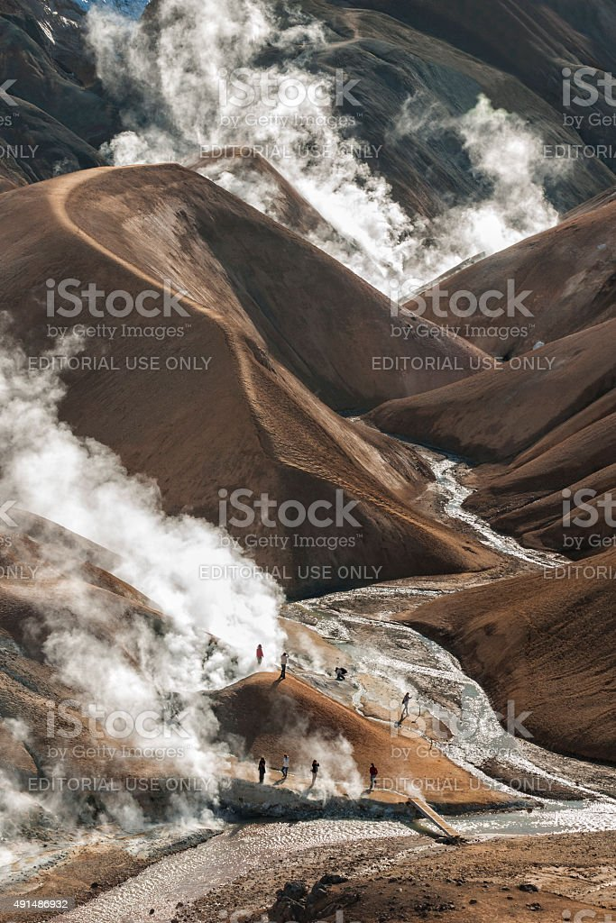 Exploring a steaming volcanic landscape stock photo