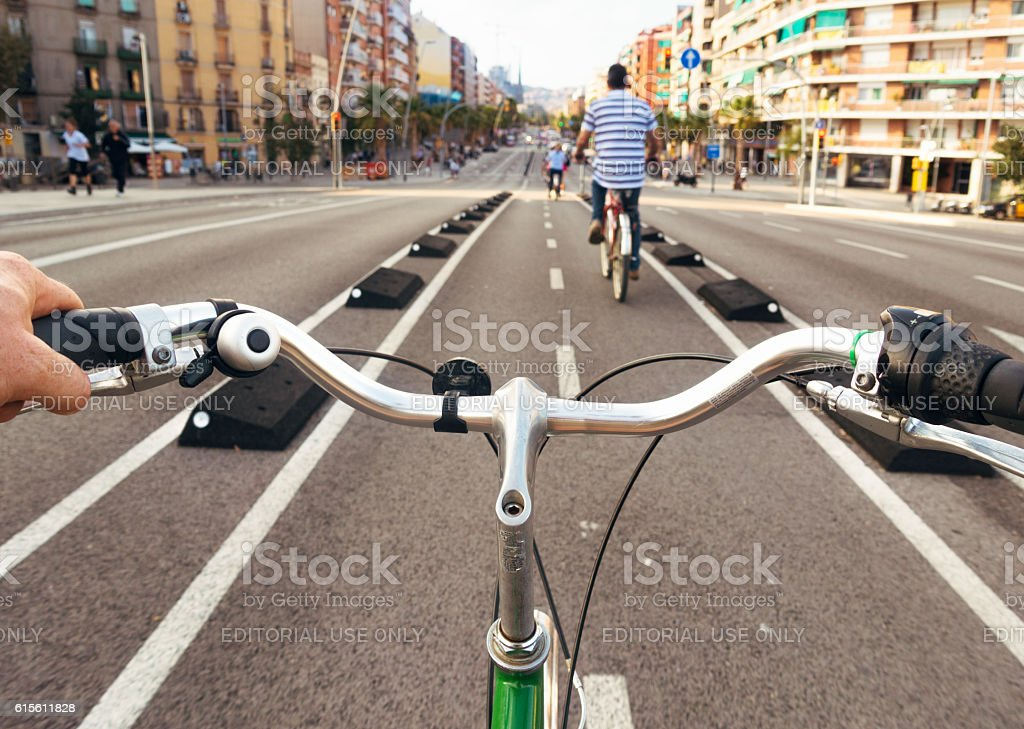Exploring Barcelona by bicycle - cyclist point of view stock photo